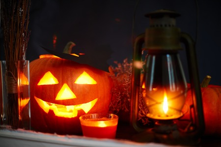 antichrist: Halloween pumpkin, lantern and burning candle