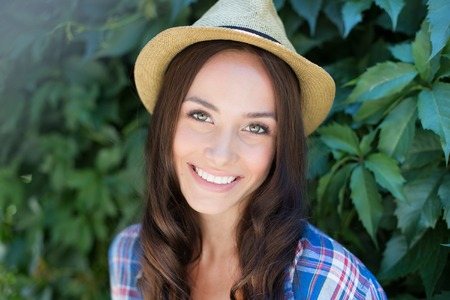Happy female in cowgirl hat looking at camera with toothy smile
