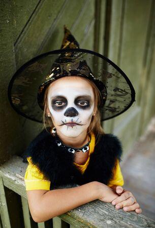 sullen: Sullen girl in Halloween costume looking at camera Stock Photo