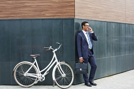 briefcase: Modern agent speaking on the phone outdoors