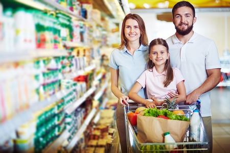 caucasian: Caucasian family looking at camera in modern hypermarket