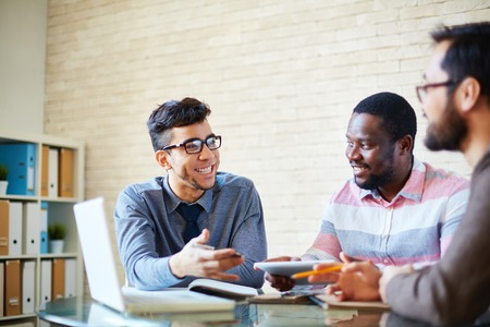employees: Three male employees discussing project Stock Photo