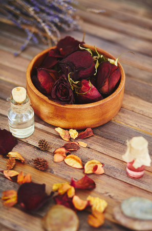 essence: Close-up of dry rose petals and essence Stock Photo