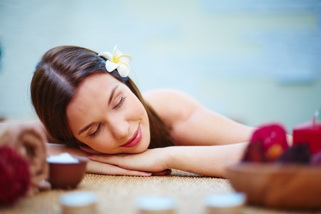 young woman face: Serene woman during spa procedure