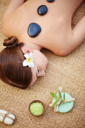 lastone: Woman relaxing at spa on mat Stock Photo