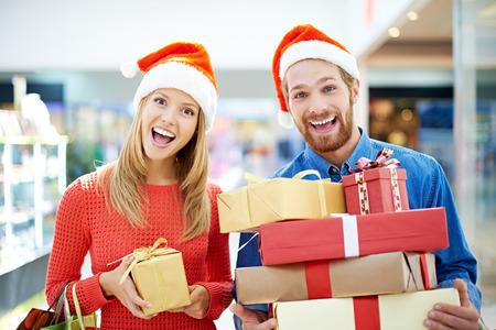 Joyful couple going shopping for Christmas