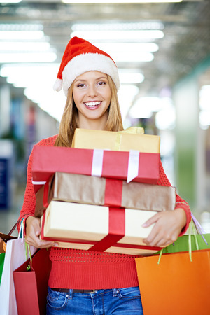 gift bags: Happy woman with gift boxes and shopping bags Stock Photo