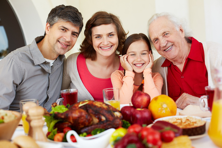 happy feast: Family of four gathering for dinner