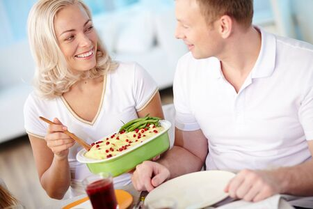 servings: Happy married couple having dinner at home Stock Photo