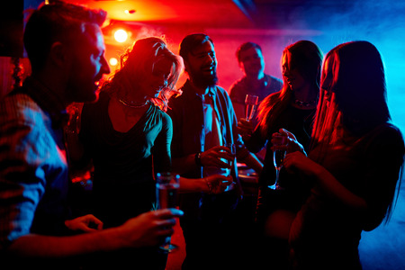 friends party: Young people spending time at nightclub Stock Photo