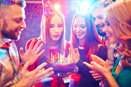 birthday adult: Young people congratulating a woman with birthday