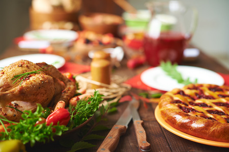 food on table: Appetizing pie and roasted chicken on the table
