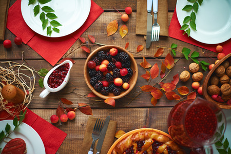 rustic: High angle view of rustic dinner table with berries