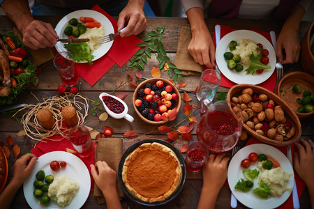 eating pastry: High angle view of festive table and people eating Stock Photo