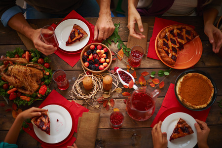 family celebration: People eating a pie and drinking cranberry compote