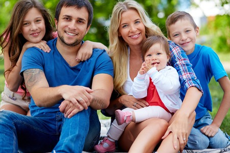 three children: Portrait of happy family with three children