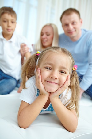 boy lady: Portrait of little daughter with her family in the background Stock Photo