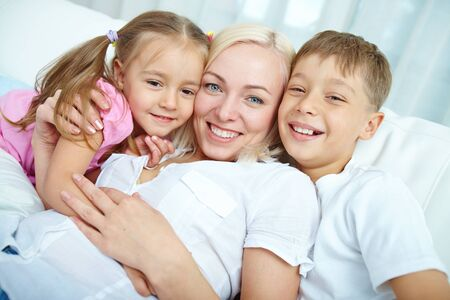 girl bonding: Happy mother with her two children Stock Photo