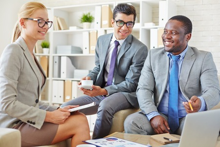 businesspeople: Businesspeople discussing some positive news