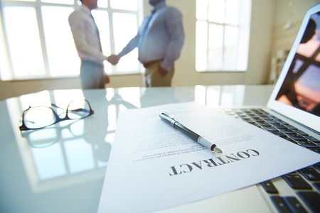 concluding: Partners concluding contract in office Stock Photo