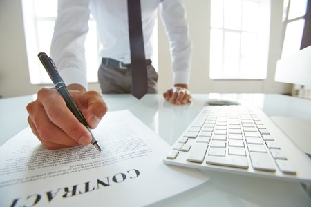 business office: Businessman reading contract with attention