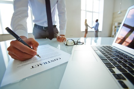 Lawyer developing contract of partnership
