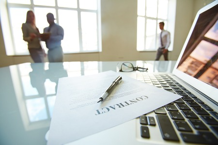 legal office: Businessman left a contract to be signed