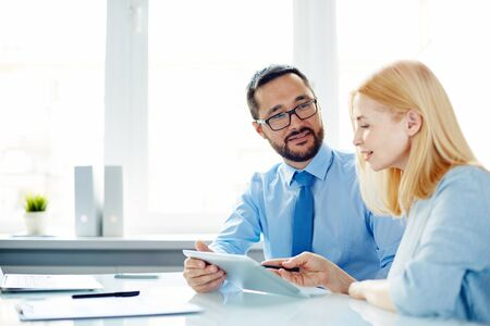 colleague: Businesswoman saying her opinion to male colleague