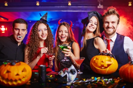 costumes: Friends drinking during Halloween night