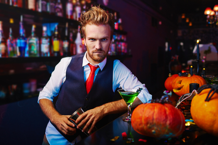 bartender: Portrait of a serious bartender working at Halloween night