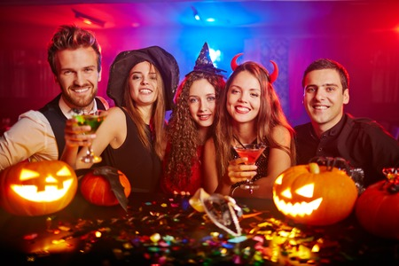 parties: Young people cheering at Halloween Stock Photo