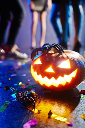 dancefloor: Jack-o-lantern and spider at nightclub