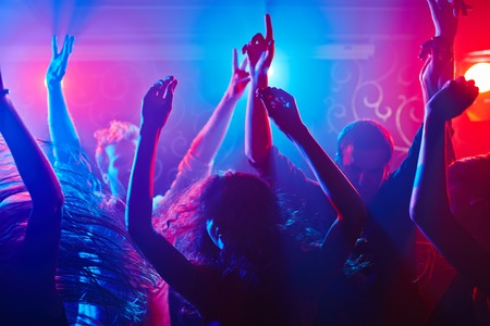 disco girls: Energetic crowd partying all night long Stock Photo
