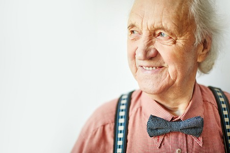 old man smiling: Senior well-dressed man looking aside