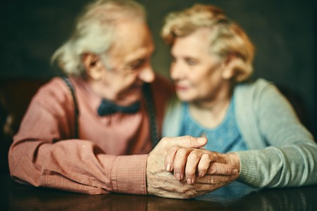 Close-up of senior man and woman hands