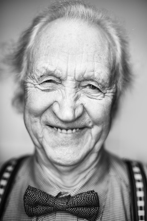 wrinkled: Elderly man with bowtie looking at camera