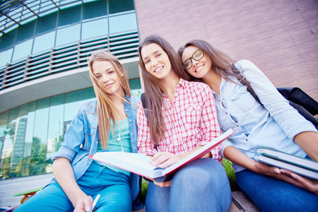 Modern teen girls from college looking at camera outdoors Stock Photo