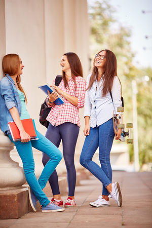 students group: Group of college students talking by their university Stock Photo