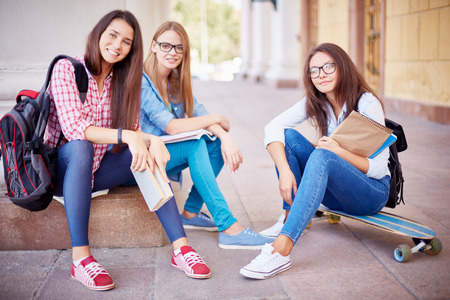 Group of pretty students looking at camera in urban environment Stok Fotoğraf - 44598716