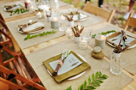 invited: Festive table served for guests invited for holiday celebration Stock Photo