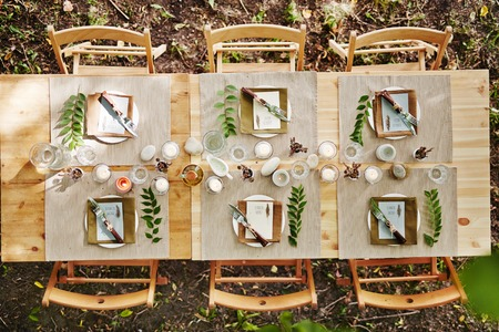 glass table: Served table and several chairs around it outdoors Stock Photo