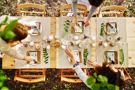 dinner: Thanksgiving table being served by waitresses Stock Photo