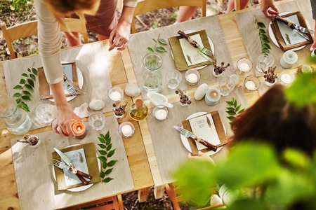 thanksgiving adult: Festive table being served by girls