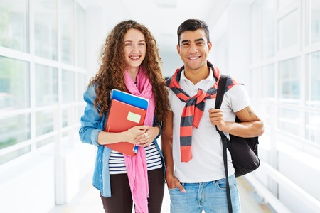 Two college learners looking at camera with smiles