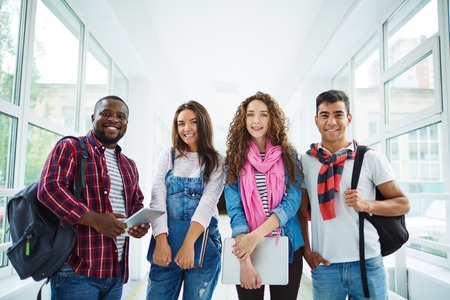 young group: Friendly students of various ethnicities looking at camera