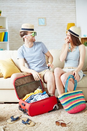 travel woman: Pretty girl laughing while her boyfriend trying on goggles before airline tour