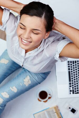 restful: Restful young woman in casualwear enjoying rest Stock Photo