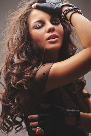 glam rock: Pretty glam rock girl with dark long curly hair