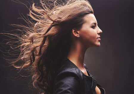 stylish hair: Profile of cool girl with long curly hair