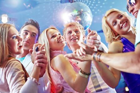 Three happy dancing couples enjoying party photo